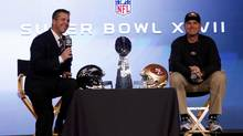 San Francisco 49ers head coach Jim Harbaugh (R) and his brother, Baltimore Ravens head coach John Harbaugh, speak during their joint press conference ahead of the NFL's Super Bowl XLVII (JIM YOUNG/REUTERS)