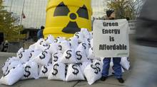 A Greenpeace activists protests against plans to build and upgrade reactors outside outside Ontario Power Generation offices in Toronto on Nov. 4, 2010. (Fred Lum/The Globe and Mail/Fred Lum/The Globe and Mail)