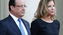 French president François Hollande and his companion Valerie Trierweiler wait for German President Joachim Gauckand, at the Elysee Palace, in Paris on Sept. 3, 2013. (Jacques Brinon/AP)