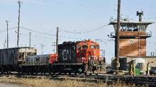 Canadian National Railway Co's tentative labor contract with about 3,000 train conductors, yardpersons, and traffic coordinators was rejected in a vote by union members. (Graham Hughes/The Canadian Press)