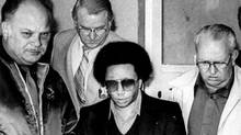 Wayne Williams, center, is led from the Fulton County Jail in Atlanta on Jan. 18, 1982, during his trial. (AP)