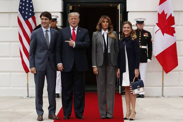 Canadian Prime Minister Justin Trudeau, left, and his wife, Sophie Grégoire Trudeau, right, are welcomed to the White House by U.S. President Donald Trump and first lady Melania Trump on Oct. 11, 2017.