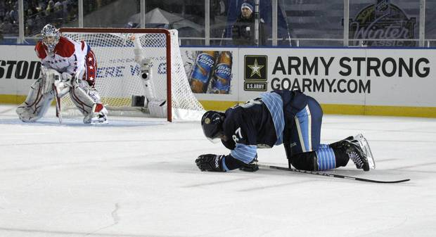 Jan. 1, 2011: The Pittsburgh Penguins' Sidney Crosby crawls on the ice after being injured in the second period of an NHL Winter Classic outdoor hockey game in Pittsburgh.