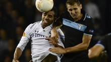 Tottenham Hotspur's Sandro (L) challenges Lazio's Miroslav Klose during their Europa League soccer match at White Hart Lane in London September 20, 2012. (DYLAN MARTINEZ/Reuters)