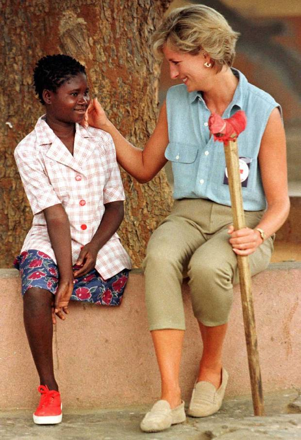 Diana, Princess of Wales, spends time with 11-year-old Sandra Tigica, January 14, the youngest patient at the Neves Bendinha orthopaedic center outside the Angolan capital Luanda, during a four-day visit to the southern African country. Young Sandra lost her leg in an air raid in 1994.