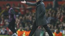 Real Madrid's coach Jose Mourinho reacts during the Champions League match against Manchester United at Old Trafford stadium in Manchester, March 5, 2013. (PHIL NOBLE/REUTERS)
