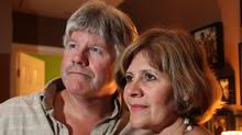 Jeff and Shelley Graham, with family photos including that of Jesse Graham, who committed suicide in his room at their home in Balderson, Ontario, near Ottawa, on June 17, 2010 at the age of seventeen. Photo By Deborah Baic/The Globe and Mail (Deborah Baic/The Globe and Mail)