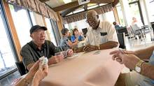 A group of seniors play bridge at the Stan Wadlow Clubhouse in the Cedarvale area of Toronto on July 27. The group meets regularly. (Kevin Van Paassen/Kevin Van Paassen/The Globe and Mail)