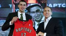 Toronto Raptors' first-round draft choice Jonas Valanciunas, left, poses with Raptors' President and GM Bryan Colangelo during a news conference in Toronto Friday, June 24, 2011. (The Canadian Press)