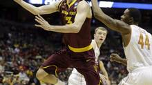 Canadian Jordan Bachynski driving the basket led the NCAA in shot blocking this past season with Arizona State. (Morry Gash/The Associated Press)
