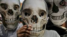 "Indian street children wear human skull masks during a "" World No Tobacco Day"" awareness rally in Kolkata, India, Tuesday, May 31, 2011. According to the World Health Organization, this year, the tobacco epidemic will kill nearly 6 million people, including some 600,000 nonsmokers who will die from exposure to tobacco smoke.( AP Photo/Sucheta Das) (Sucheta Das/AP)"