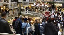 Holiday shoppers race through the Eaton Centre in Toronto on Monday, Dec. 23, 2002. (FRANK GUNN/FRANK GUNN/The Canadian Press)