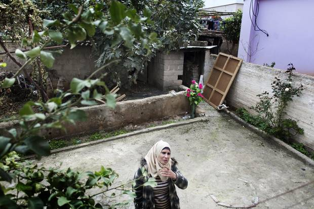 Suheir Salameh is shown at the home of her husband's parents in the village of Bidya.