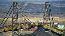 Existing mining projects, which have been around for decades with billions already invested, are better shielded from lower prices. (Jimmy Jeong/Bloomberg News/Jimmy Jeong/Bloomberg News)