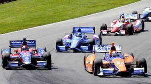 Charlie Kimball leads Marco Andretti, Dario Franchitti and Justin Wilson through a corner during the Honda Indy 200 at Mid-Ohio Sports Car Course in Lexington, Ohio Sunday, August 4, 2013.