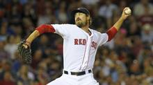 Boston Red Sox relief pitcher Andrew Miller pitches during the seventh inning against the Toronto Blue Jays at Fenway Park. (Bob DeChiara/USA Today Sports)