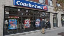 A man passes by a Couche-Tard convenience store in Montreal. (Graham Hughes/THE CANADIAN PRESS)