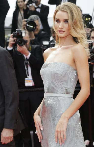 You thought the Cannes Film Festival was over? Pas tout à fait. Here we find Rosie Huntington-Whitely breaking out her best dead-eyed model face at the premiere of The Search. See what happens to your career when you appear in a Transformers movie? (Thibault Camus/AP)