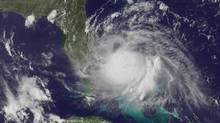 A July 1, 2014, satellite image released by the U.S. National Oceanic and Atmospheric Administration shows the centre of tropical storm Arthur off the east coast of Florida. (NOAA/ASSOCIATED PRESS)
