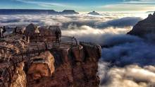 Sea of clouds: The interaction of cold and warm air masses causes a rare total cloud inversion in the Grand Canyon in Arizona. (Erin Whittaker/Associated Press)