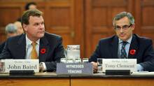 Foreign Affairs Minister John Baird and Treasury Board President Tony Clement appear before the Commons public accounts committee looking into G8 spending on Nov. 2, 2011. (Sean Kilpatrick/THE CANADIAN PRESS)