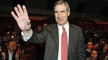 Liberal Leader Michael Ignatieff waves to spectators as he takes the stage at Laval University in Quebec City on November 26, 2009. (MATHIEU BELANGER)
