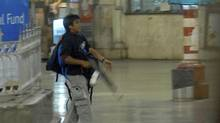 A Nov. 26, 2008 file photo shows gunman Mohammed Ajmal Kasab walking through the Chatrapathi Sivaji Terminal railway station in Mumbai. (Sebastian D'souza/Mumbai Mirror/AP)