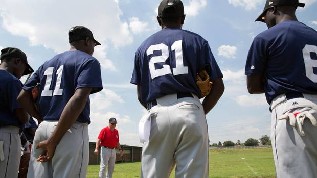 Coach Garth Iorg speaks to baseball players at the MLB African Elite camp.