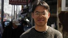 Author Vincent Lam poses for a portrait on Gerrard St. near Toronto's Chinatown East, April 19, 2012. (Fernando Morales/The Globe and Mail)