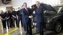 Ontario Premier Dalton McGuinty, left, and Prime Minister Stephen Harper are seen at the Toyota plant in Cambridge, Ont. Wednesday, January 23, 2013. The two were on hand to announce new investment in the production of hybrid vehicles. (Kevin Van Paassen/The Globe and Mail)