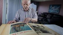 Henri Beaudout is photographed with his scrapbook in his Montreal home on August 3, 2012. (Christinne Muschi/Christinne Muschi/The Globe and)