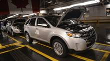 Vehicles on the assembly line at Ford Motor Co. of Canada's Oakville Assembly Plant. (Fred Lum/The Globe and Mail)