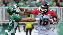 Calgary Stampeders' Marquay McDaniel (R) is tackled by Saskatchewan Roughriders' Graig Newman during the second half of their CFL game in Regina August 25, 2012. (FRED GREENSLADE/REUTERS)