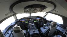 In this Oct. 1, 2012 file photo, the flight deck of a Boeing 787 is shown at Seattle-Tacoma International Airport. Boeing's Dreamliner has had a rough week, capped off Friday with a decision by the Federal Aviation Administration to review the plane's assembly and manufacture. (Ted S. Warren/AP)