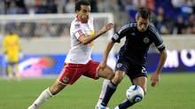 Davy Arnaud #22 of the Sporting Kansas City is pursued by Dwayne De Rosario #17 Red Bulls of the Sporting Kansas City at Red Bull Arena on April 30, 2011 in Harrison, NJ. (Chris Trotman/2011 Getty Images)