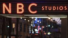 In this Aug. 21, 2009 file photo, the NBC logo glows in neon lights at its headquarters in New York. The head of the Federal Communications Commission is laying out regulatory conditions Thursday, Dec. 23, 2010, to ensure that cable giant Comcast Corp. cannot stifle video competition once it takes control of NBC Universal. (AP Photo/Bebeto Matthews, file) (Bebeto Matthews, file/AP)