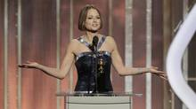 Actress Jodie Foster (L) accepts the Cecil B. Demille Award, on stage on at the Golden Globe Awards in Beverly Hills, California January 13, 2013. (HANDOUT/REUTERS)