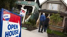 Potential buyers arrive at an open house in the Strathcona neighbourhood of Vancouver on April 6, 2014. (Rafal Gerszak for The Globe and Mail)
