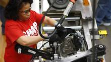 In this March 14, 2014 photo, an assembly line worker builds a 2015 Chrysler 200 automobile at the Sterling Heights Assembly Plant in Sterling Heights, Mich. (Paul Sancya/AP)