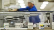 Centrum multivitamins are shown on the packaging line at the Pfizer plant in Montreal, Thursday, July 12, 2012. Pfizer Canada is teaming with AstraZeneca Canada and the government of Quebec on a new research facility. (Graham Hughes/THE CANADIAN PRESS)