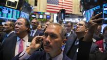 Traders work on the floor of the New York Stock Exchange shortly after the opening bell in New York April 16, 2014. (LUCAS JACKSON/REUTERS)