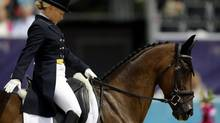 Hawley Bennett-Awad, of Canada, and her horse Gin and Juice, compete in the equestrian eventing dressage competition at the 2012 Summer Olympics, Saturday, July 28, 2012, in London. (David Goldman/AP)