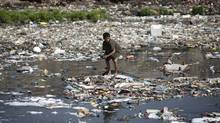A boy looks for plastic bottles at the polluted Bagmati River in Kathmandu, March 22, 2013. This year's theme for World Water Day, which falls on March 22, is 'Water Co-operation' and is in line with the celebration of the International Year of Water Co-operation. (NAVESH CHITRAKAR/REUTERS)