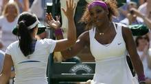 Serena Williams of the U.S. (R) prepares to shake hands with Zheng Jie of China after defeating her in their women's singles tennis match at the Wimbledon tennis championships in London June 30, 2012. (STEFAN WERMUTH/REUTERS)