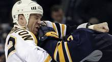 Buffalo Sabres' Mike Weber, right, fights with Boston Bruins' Shawn Thornton during the second period of an NHL hockey game in Buffalo, N.Y., Wednesday, Feb. 8, 2012. (David Duprey/AP/David Duprey/AP)