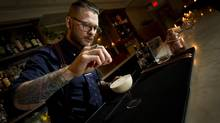 Bartender Michael Mooney puts the finishing touches on a cocktail called the Cloud of Cassia at Geraldine's in Toronto. (Kevin Van Paassen/The Globe and Mail)