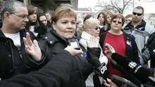 Carol deDelley, mother of Tim McLean, and family members talk to media outside the Law Courts in Winnipeg on Thursday, March 5, 2009 after the verdict from the trial of Vince Li, the man who stabbed and beheaded McLean on a Greyhound Bus this past summer in Manitoba. Li was found to be not criminally responsible for killing Mclean. (John Woods/The Canadian Press)