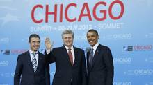 U.S. President Barack Obama (R) and NATO Secretary-General Anders Fogh Rasmussen (L) welcome Prime Minister of Canada Stephen Harper at the NATO Summit in Chicago, May 20, 2012. (JASON REED/REUTERS/JASON REED/REUTERS)