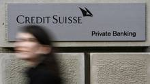 A woman walks past an office building of Swiss bank Credit Suisse at the Bahnhofstrasse in Zurich December 4, 2008. (ARND WIEGMANN/REUTERS)