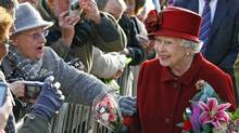 Britain's Queen Elizabeth, right, greets members of the public after visiting the Museum of Liverpool in Liverpool, England, Thursday, Dec. 1, 2011. (Tim Hales/Tim Hales / AP)